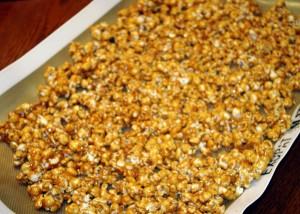 spreading caramel popcorn