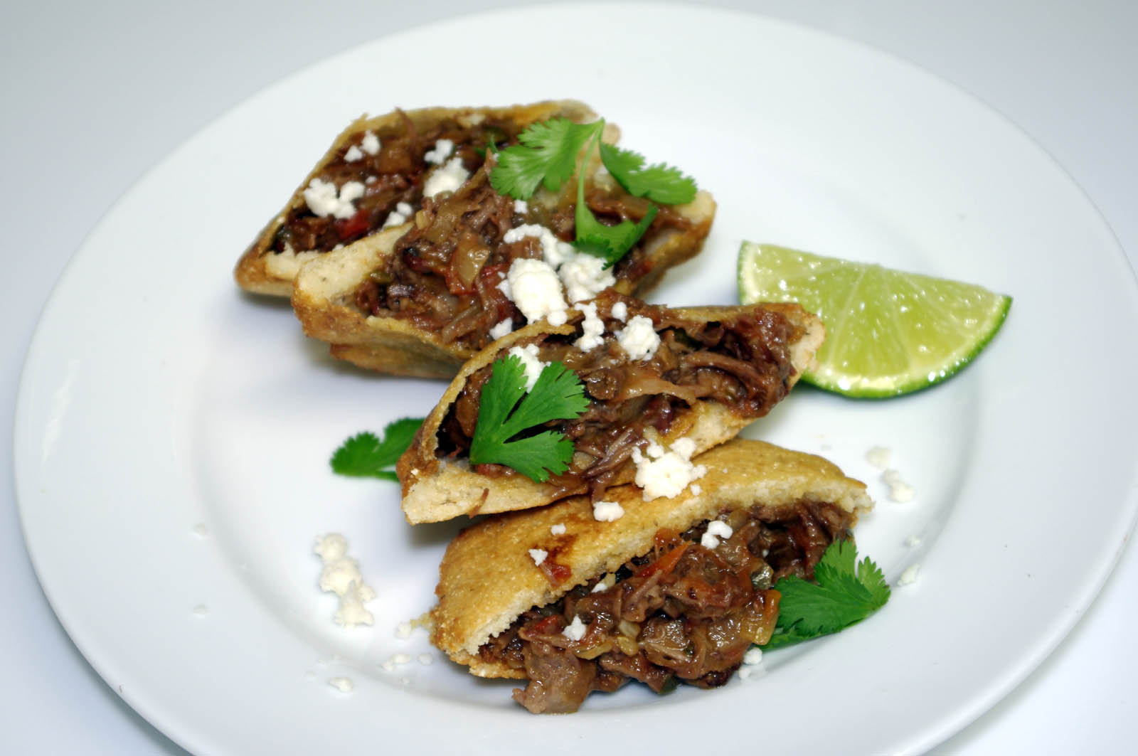 Beer Braised Short Rib Gorditas w/Smokey Refried Black Beans